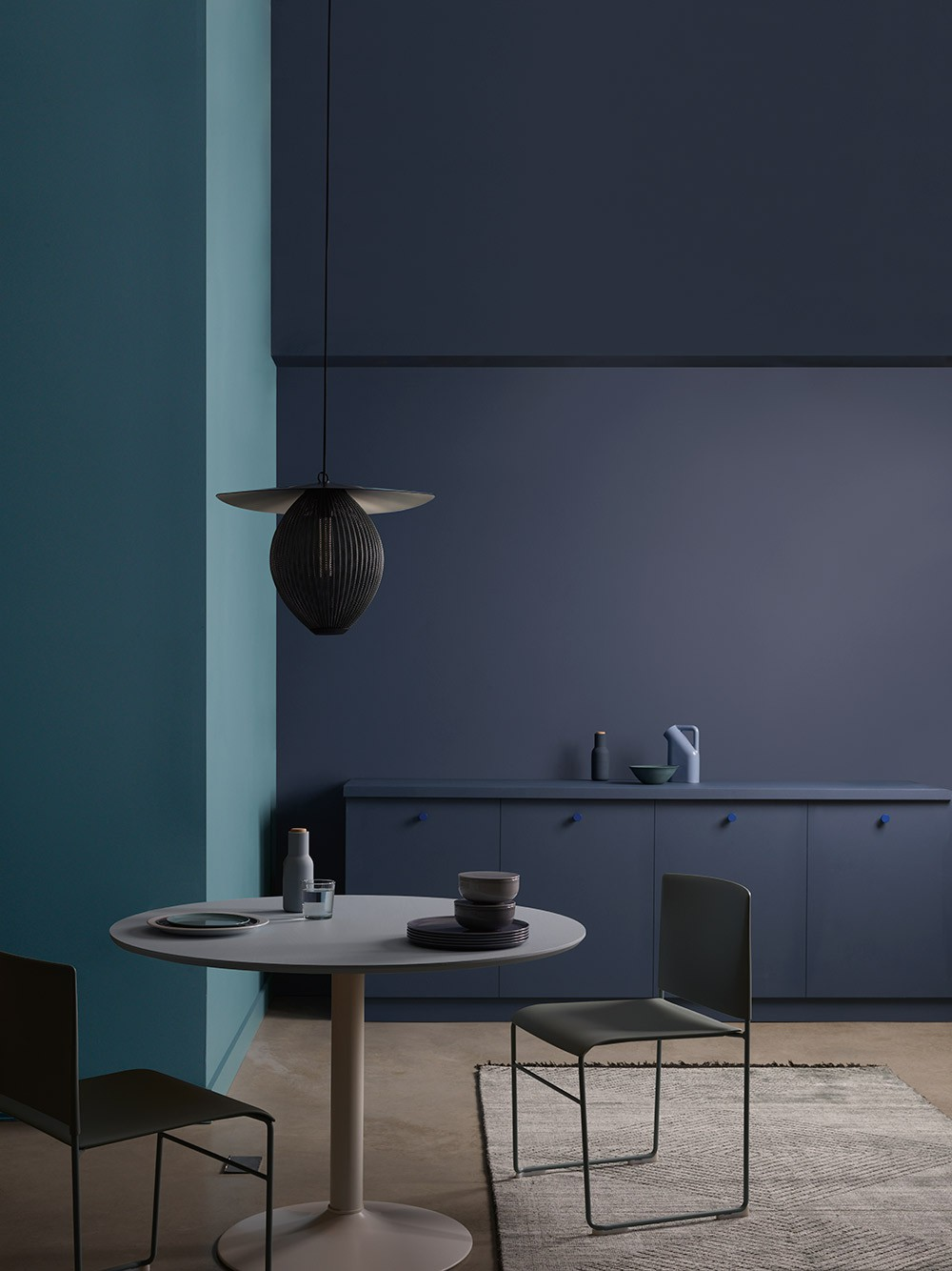 Blue and purple walls with dining table