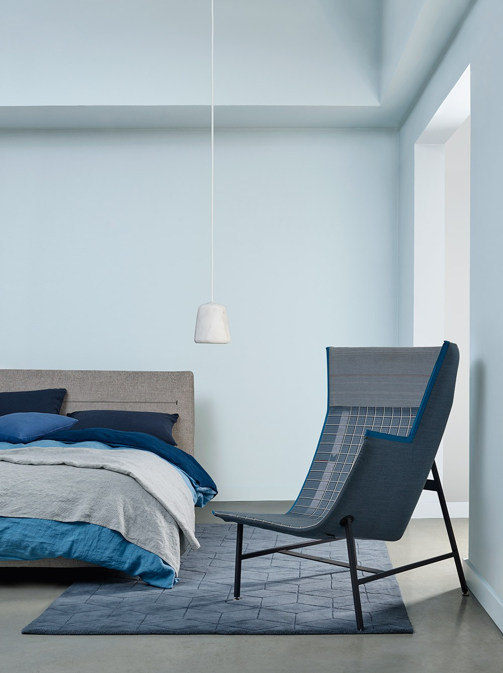 Blue walls with bed and chair