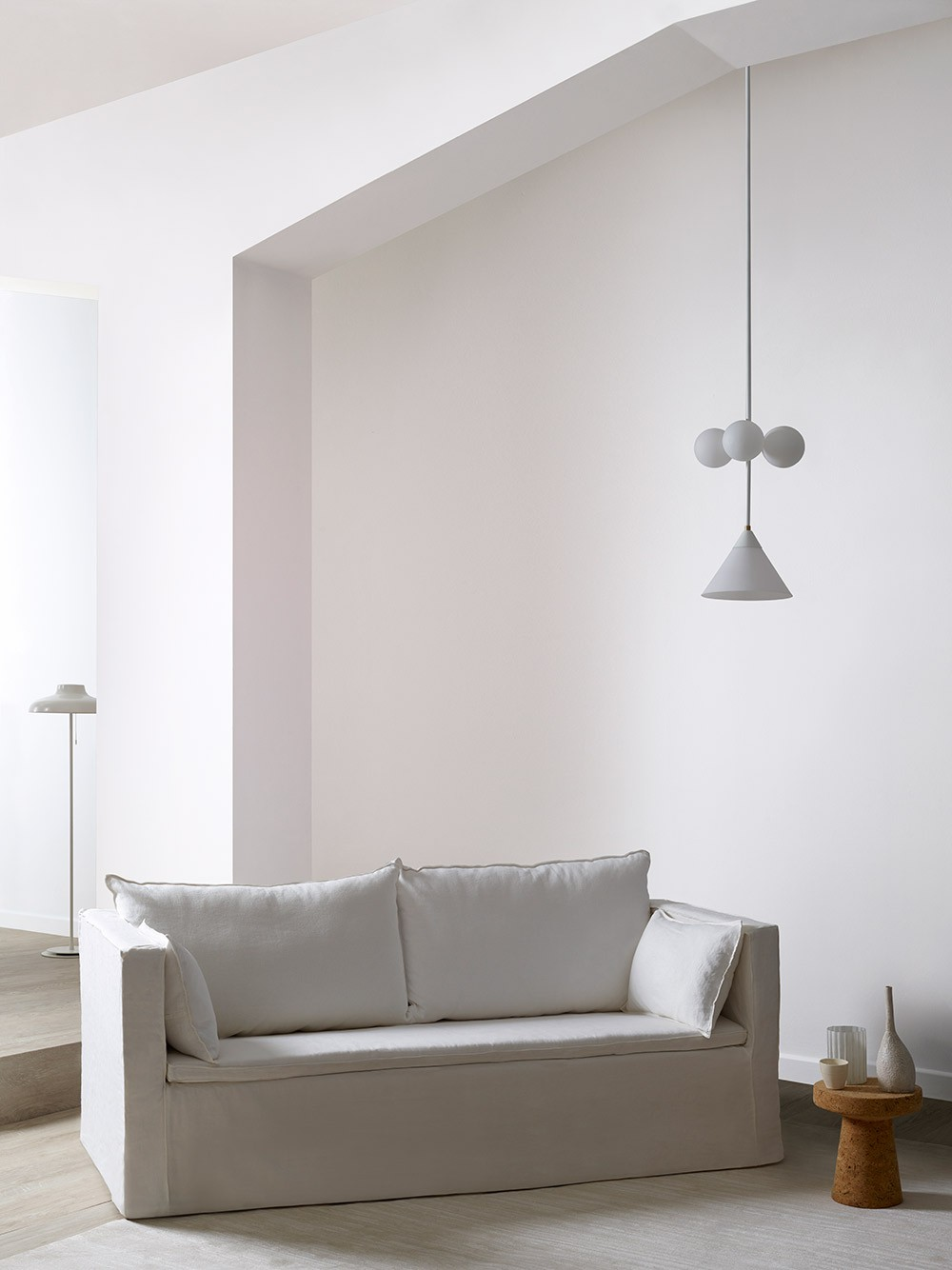 White walls with white sofa